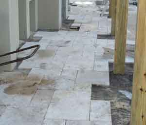 natural stone pavers being installed in Orlando Florida in a french pattern