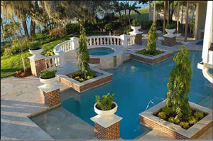 pool landscaping in winter springs florida with a firepit and summer kitchen